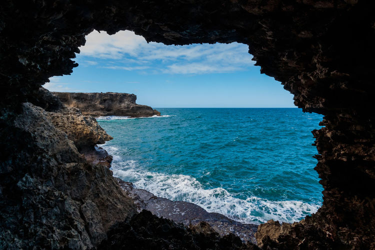 Amazing View Barbados Barbados 2016 Amazing Animal Flower Cave Beauty In Nature Cliff Day Horizon Over Water Natural Arch Nature No People Outdoors Physical Geography Rock - Object Rock Formation Scenics Sea Sky Tranquil Scene Tranquility Water