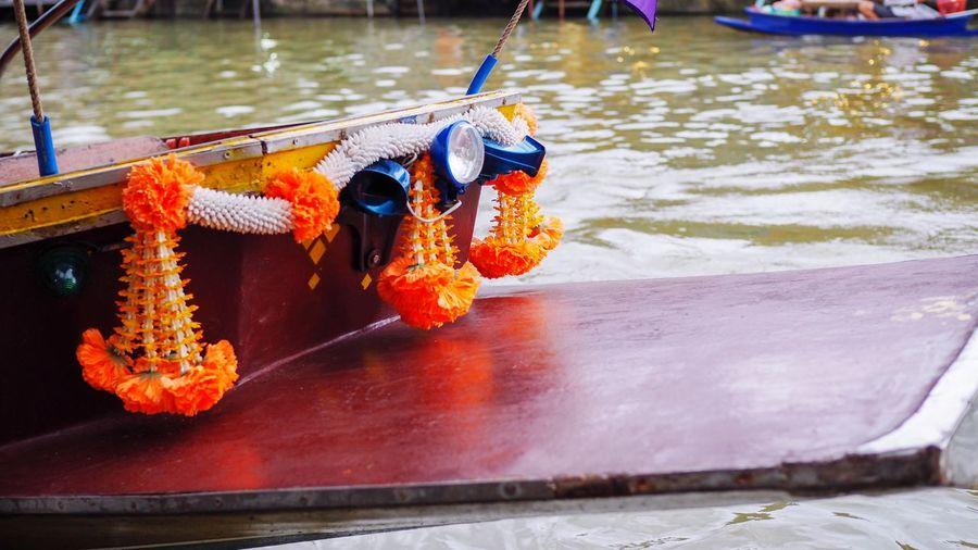 Flower decoration in front of a thai river boat.