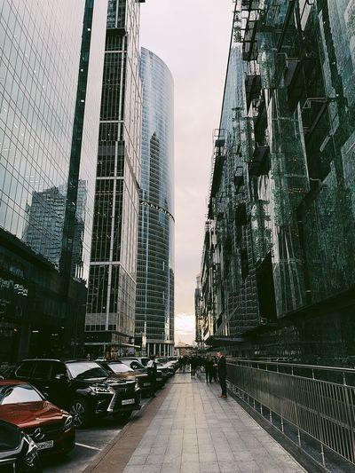 Street amidst buildings in city against sky