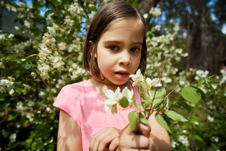 Portrait of cute girl with plants