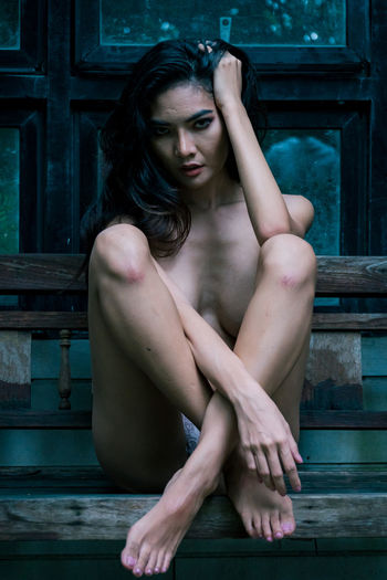 Naked Young Woman Sitting On Bench