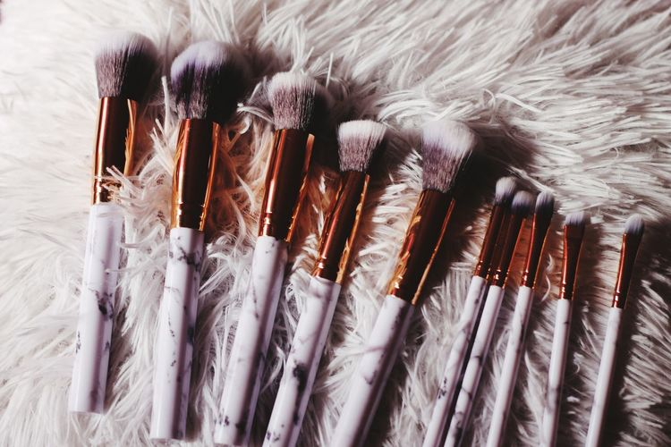 Close-Up Of Make-Up Brushes On Rug