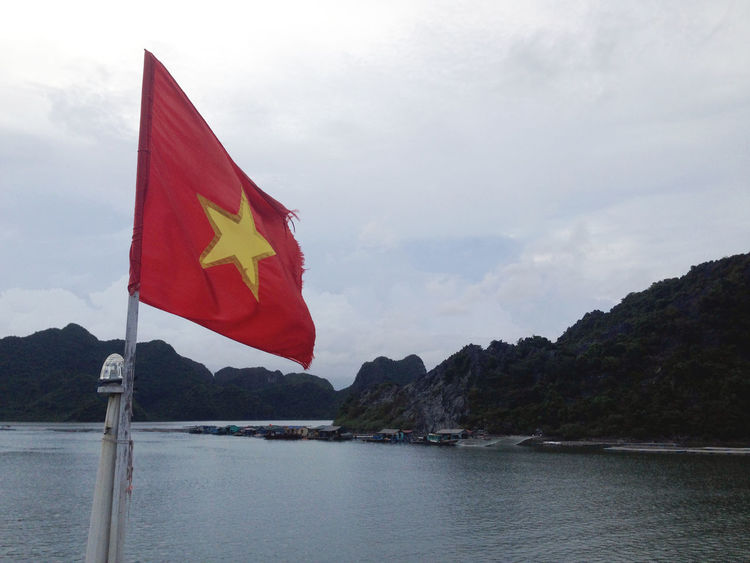 Vietnam flag, boat cruise at Halong Bay, Vietnam Beauty In Nature Boat Flag Cloud - Sky Contrast Day Flag Halong Bay Vietnam Mountain Nature No People Outdoors Patriotism Red Scenics Sky Tranquility Vietnam Vietnam Flag Water Yellow Star