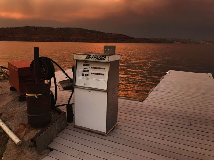 Water Lakeside Unleaded Global Warming Dramatic Sky Wyoming Travel Destinations Dusk Nature Sky No People Scenics Tranquility Outdoors Mountain Beauty In Nature Sunset Day