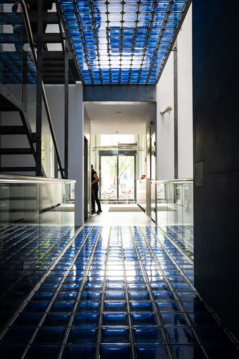 Amsterdam Architecture Foam Photography Museum  Adult Architecture Building Built Structure Business City Day Door Entrance Flooring Gallery Glass - Material Indoors  Leaving Modern People Reflection Staircase Tiled Floor Transportation Walking Window