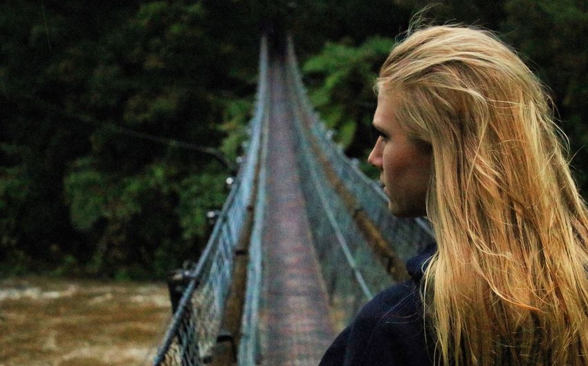 Been There. One Person Real People Leisure Activity Focus On Foreground Outdoors Side View Lifestyles Forest Day Blond Hair Headshot Tree Young Women Nature Young Adult Smiling Happiness People Lord Of The Rings Rivendell New Zealand Swinging Bridge Bridge The Week On EyeEm