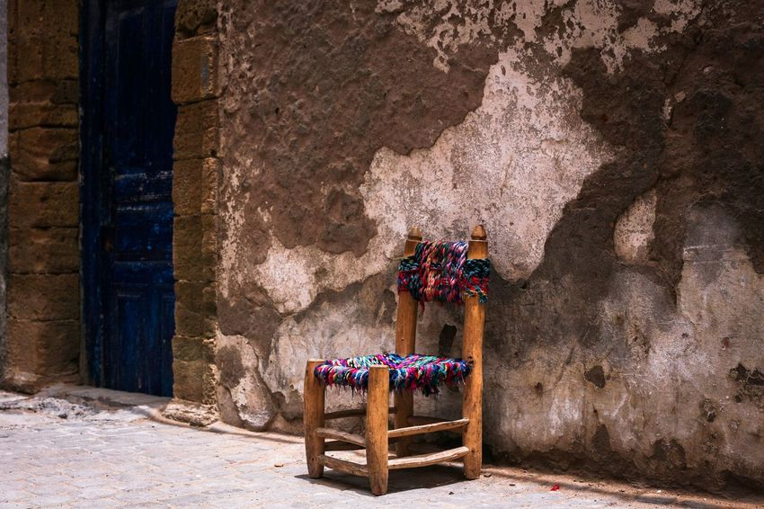 Empty chair in Essaoira, Morocco Outdoors Day City Weathered No People Building Exterior Explore Architecture Door Chair Bad Condition Tranquil Scene Tranquility