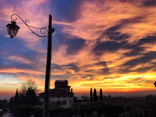 Shotoniphone7 ShotOnIphone Asolo, Italy Asolo Amazing Sky Skyporn Dramatic Sky Lamp Post Sunset Cloud - Sky Sky Orange Color Dramatic Sky Architecture No People Building Exterior Built Structure Low Angle View Silhouette Outdoors Nature Travel Destinations Beauty In Nature Tree