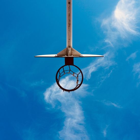 Basketball hoop and blue sky in the street