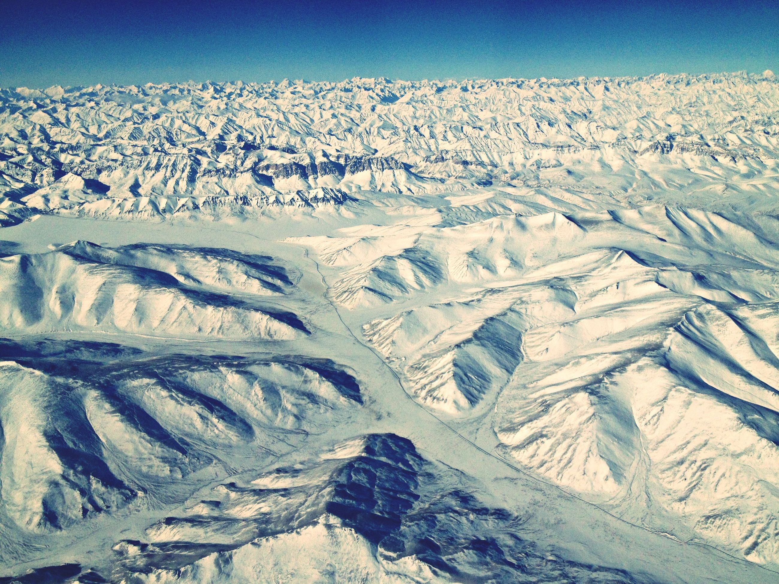 snow, winter, cold temperature, landscape, season, tranquility, tranquil scene, scenics, beauty in nature, nature, blue, mountain, clear sky, snowcapped mountain, covering, weather, white color, aerial view, mountain range, non-urban scene