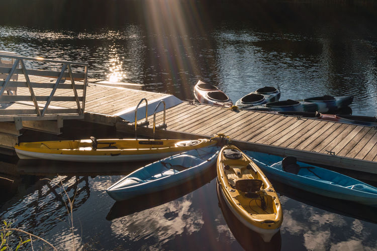 Kayaks moored on a small wooden pier