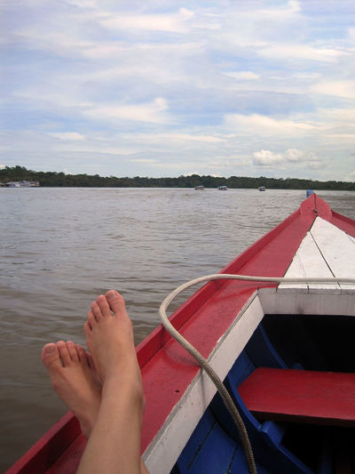 Amazonas River An Eye For Travel Manaus barefoot Cloud - Sky Day Human Body Part Human Leg Lake Low Section Nature Nautical Vessel One Person Outdoors People Real People Red Relaxation Sky Water