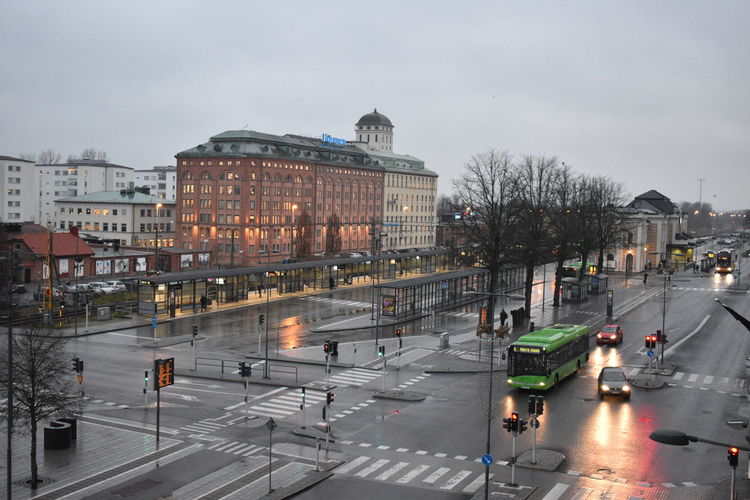 An early morning scene near Kristianstad Central train station in Sweden Building Exterior Architecture City Built Structure Transportation Road Motor Vehicle Mode Of Transportation Car Land Vehicle Street Sky Road Marking Nature Sign Incidental People Symbol Marking Wet Rain Outdoors Light Road Junctionsquare Streetphotography