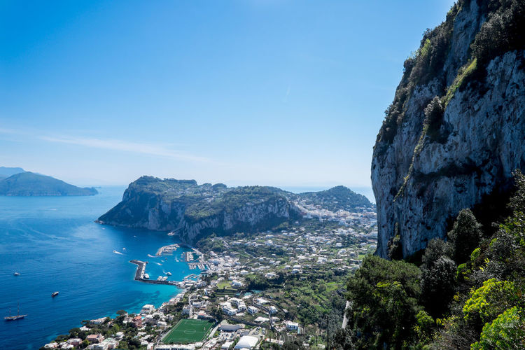 Capri - Paradise on Earth! Water Mountain Sky Sea Scenics - Nature Beauty In Nature Nature Rock Blue Day Rock - Object Land Rock Formation Solid Tranquil Scene Copy Space Architecture Tranquility Outdoors Mountain Range No People Capri Italy Europe Cliffs Island Harbour City Amazing View Sunny Day Greenery Dock Marina