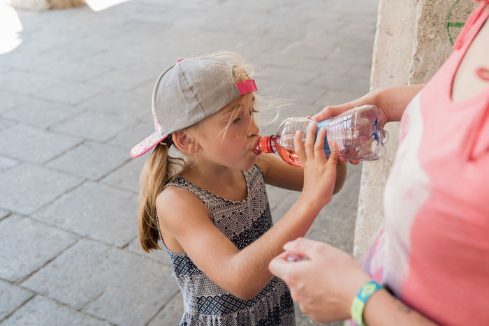 Eline drinking on a hot summer day Thirsty  Bonding Bottle Cap Childhood Daughter Day Drink Drinking Drinking Water Elementary Age Family Food And Drink Girls Healthy Leisure Activity Outdoors Real People Summer Sun Hat Togetherness Two People Vacations Water