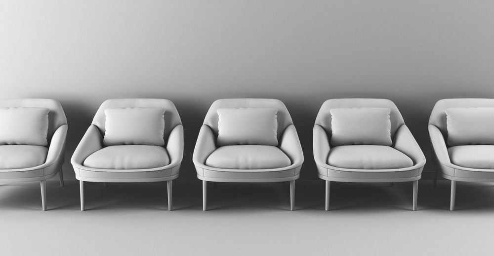 Close-up of empty chairs against white background