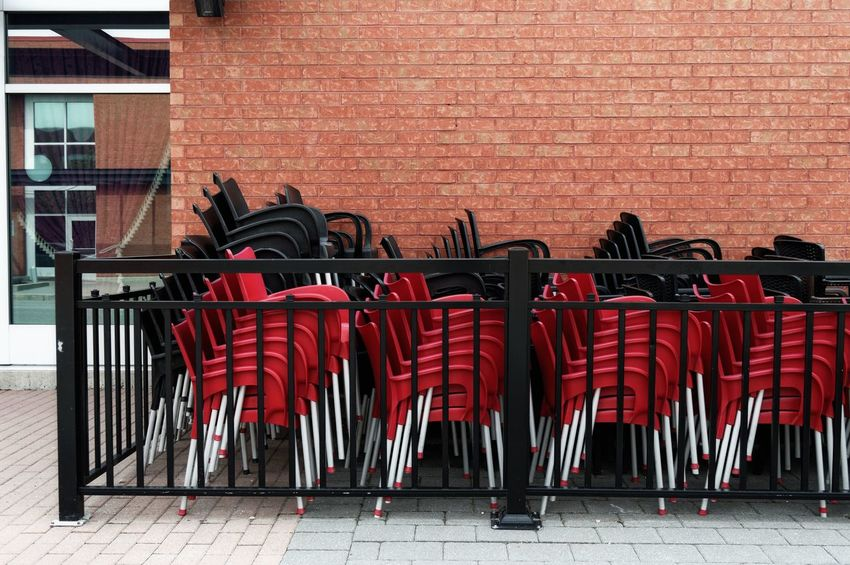 Architecture Black Brick Wall Building Exterior Built Structure Centropolis Chair Chairs Day In A Row No People Outdoors Red Stacked Stacked Chairs Streetphotography Terrasse Urbanexploration