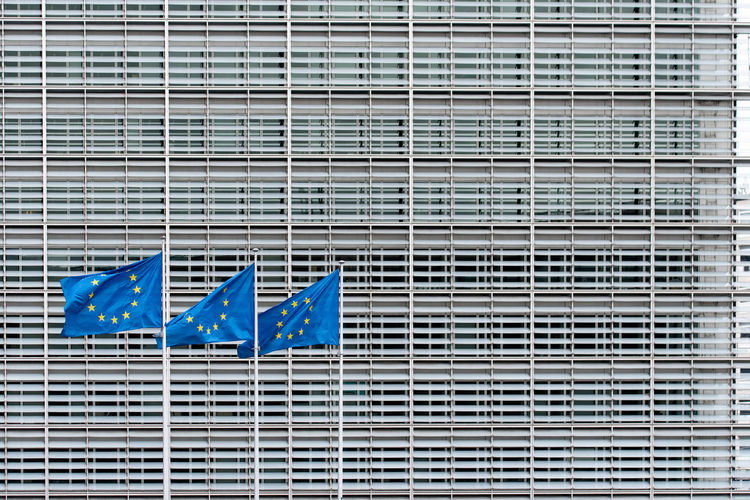 Full frame shot of office building with three european flags