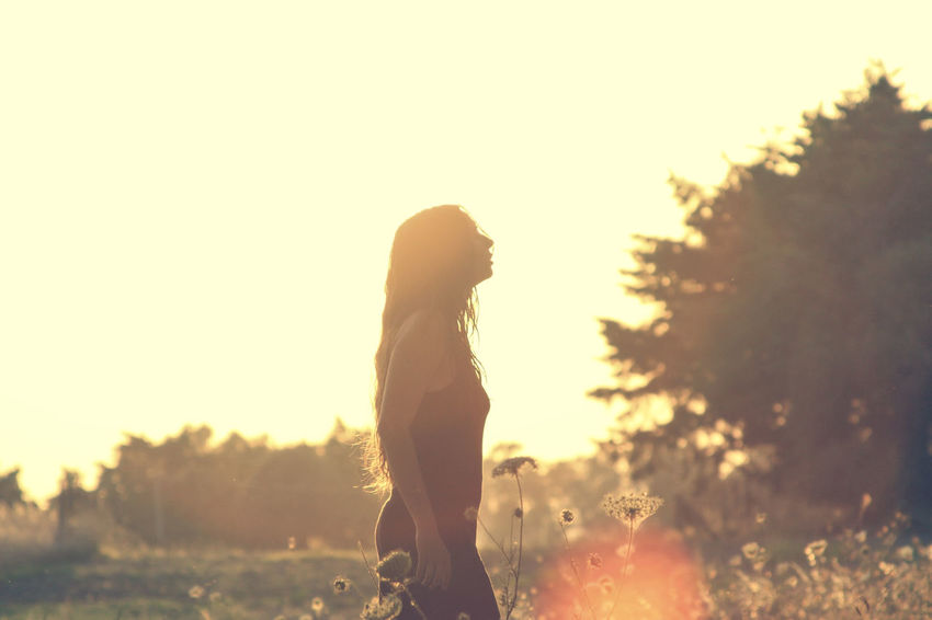 Back Lit Beauty In Nature Day Focus On Foreground Idyllic Landscape Leisure Activity Lens Flare Lifestyles Nature Non-urban Scene Orange Color Outdoors Scenics Silhouette Sky Sun Sunbeam Sunlight Sunset Tranquil Scene Tranquility Woman