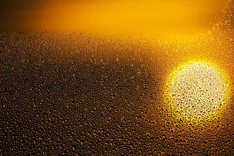 Full frame shot of wet yellow illuminated at night