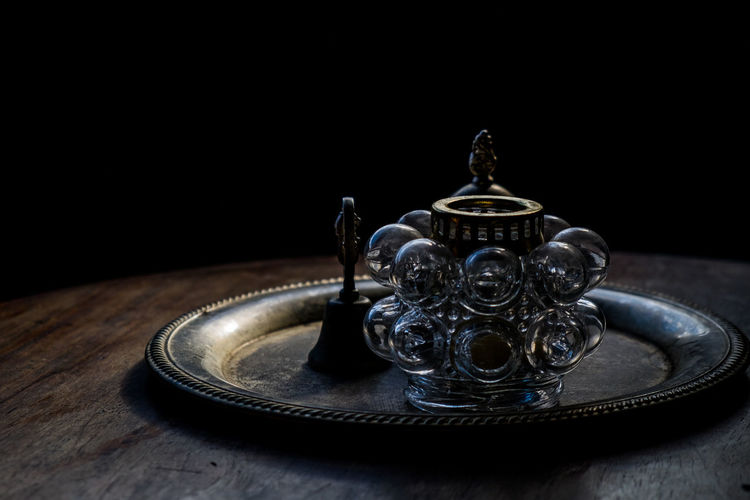 Antique Bell Black Background Brass Candle Holder Classic Close-up Copy Space Glass Golden Historic Item Luxury No People Old Items Old-fashioned On The Table Ornament Platter Spanish Era Table Wood - Material 10 The Still Life Photographer - 2018 EyeEm Awards Autumn Mood