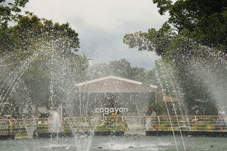 Fountain in park during rainy season