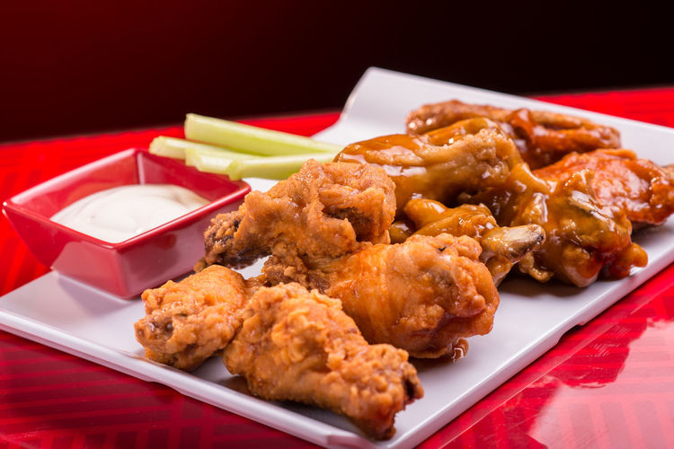 Tasty Chicken Wings Spicy Appetizer Barbecue Buffalowings Celery Chicken Leg Chicken Meat Chicken Wing Close-up Deep Fried  DIP Food Fried Chicken Meal No People Plate Pub Food Ready-to-eat Red Table Sauce Tasty, Snack, Food, Eating, Tray White