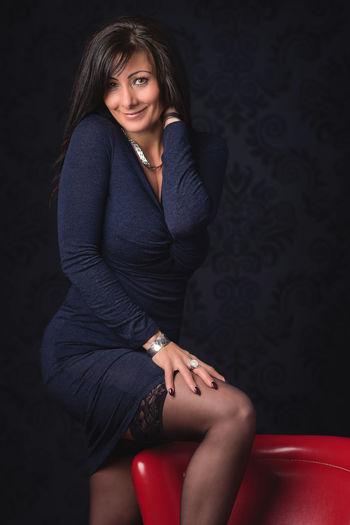 Portrait Of Smiling Beautiful Woman Wearing Dress