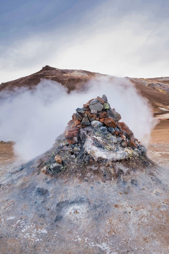 A pile of boulders under which hot steam escapes, iceland