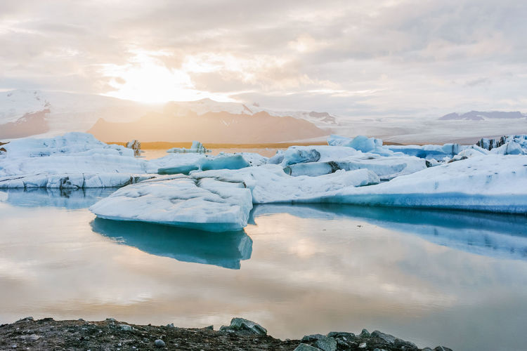 Jokulsarlon glacier lagoon, melting ice, Iceland. Beauty In Nature Cloud - Sky Cold Temperature Environment Floating On Water Frozen Glacier Ice Iceberg Lagoon Landscape Melting Nature No People Reflection Scenics - Nature Sky Snow Snowcapped Mountain Tranquil Scene Tranquility Water Winter