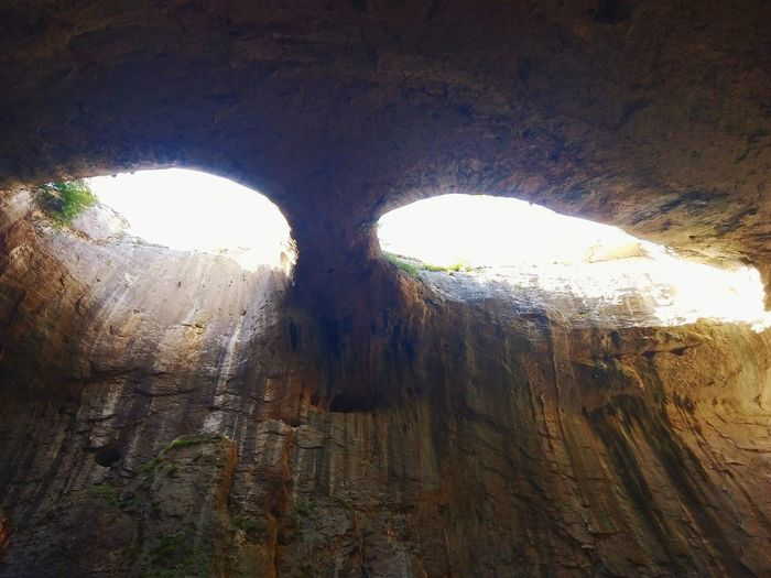 God's eyes Sunlight Cave Formations Cave Natural Phenomena Geological Formation Gods Eyes Nature Mountains Travel Rock Formation Cave Natural Arch