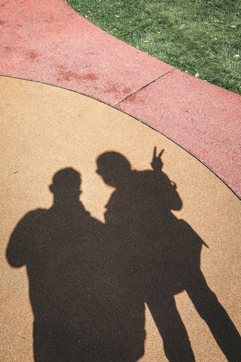 Adult Adults Only Day Focus On Shadow Friendship Grass High Angle View Leisure Activity Lifestyles Men Outdoors People Real People Sand Shadow Sunlight Togetherness Two People Women