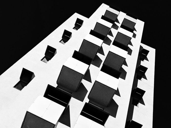 Low angle view of building against black background