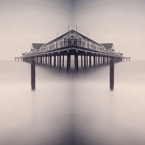 Re a pier Built Structure Architecture Building Exterior Waterfront Architectural Column Standing Water Tranquility Pier Long Exposure Sea And Pier Southwold Mirrored Symmetry My Favorite Place Seaside Seascape BW Landscape Tranquil Scene Scenics Fine Art Photography EyeEm Masterclass Sea And Sky Monochrome Photography