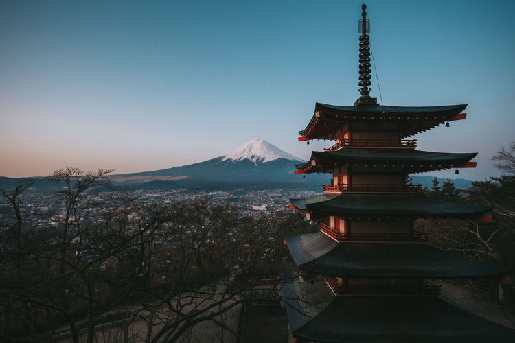 Architecture Religion Belief Sky Built Structure Spirituality Place Of Worship Building Exterior Building Mountain Nature No People Tree Travel Destinations Pagoda Tourism Travel Outdoors Spire  Japan Dusk Dawn Snowcapped Mountain Snow