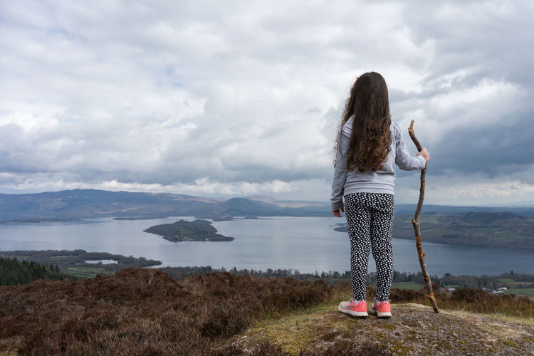 On top of the world looking down over Loch Lomond One Person Cloud - Sky Long Hair Rear View Hair Hairstyle Mountain Scenics - Nature Women Beauty In Nature Sky Casual Clothing Water Leisure Activity Standing Full Length Real People Tranquil Scene Adult Looking At View Outdoors Human Arm
