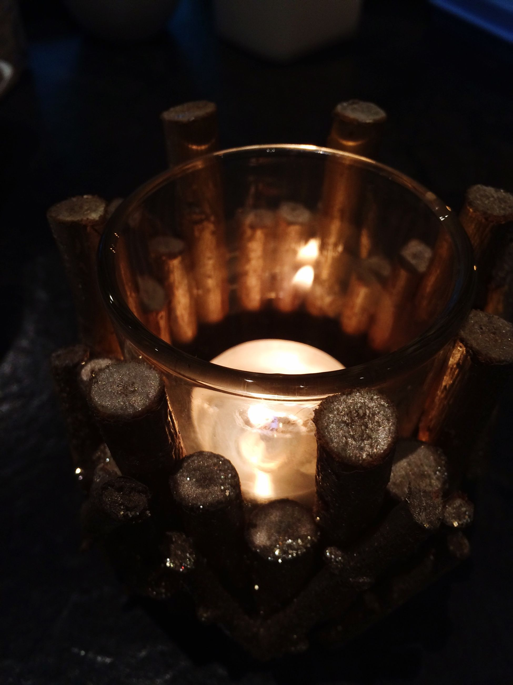 indoors, flame, burning, heat - temperature, candle, food and drink, fire - natural phenomenon, close-up, still life, drink, table, glowing, lit, refreshment, glass - material, freshness, high angle view, candlelight, illuminated, fire