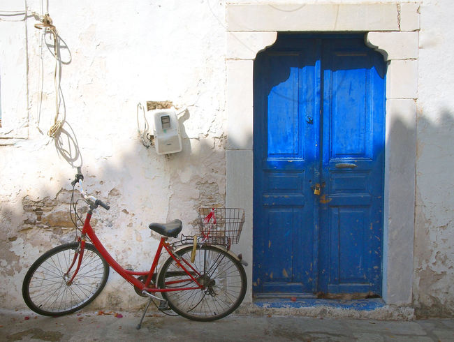 red bicycle and blue door in kos greece Blue Door Architecture Bicycle Blue Building Building Exterior Built Structure Closed Day Door Entrance Greece House Kos Land Vehicle Mode Of Transportation No People Outdoors Protection Safety Security Transportation Wall - Building Feature