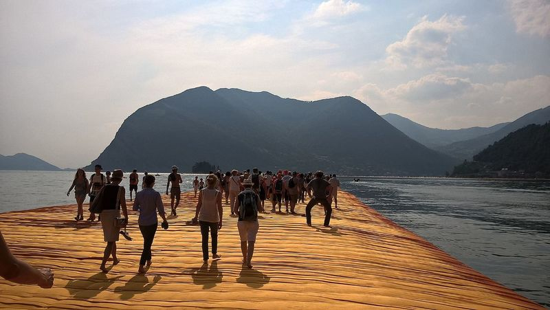 Beauty In Nature Cloud - Sky Coastline Floating Piers Idyllic Leisure Activity Lifestyles Medium Group Of People Mixed Age Range Mountain Mountain Range Non-urban Scene Outdoors Rock Formation Scenics Sea Shore Sky Tourism Tourist Tranquil Scene Tranquility Travel Destinations Vacations Water