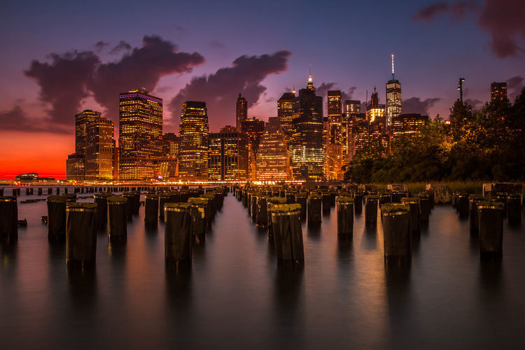 A view of the Manhattan Skyline from Brooklyn Bridge Park. Brooklyn Brooklyn Bridge / New York City Golden Hour Illuminated Long Exposure Manhattan New York City Night Nightphotography No People NYC NYC Photography Reflection Sky Skyline Skyscraper Skyscrapers Sunset Water Water Reflections Waterfront