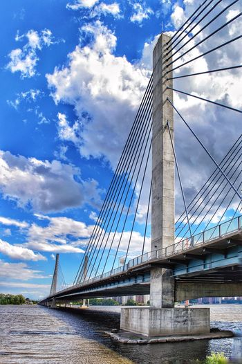 Bridge - Man Made Structure Connection Sky Engineering Cloud - Sky Transportation Suspension Bridge Architecture Built Structure Outdoors Day River Bridge Low Angle View No People Blue Travel Water Travel Destinations City