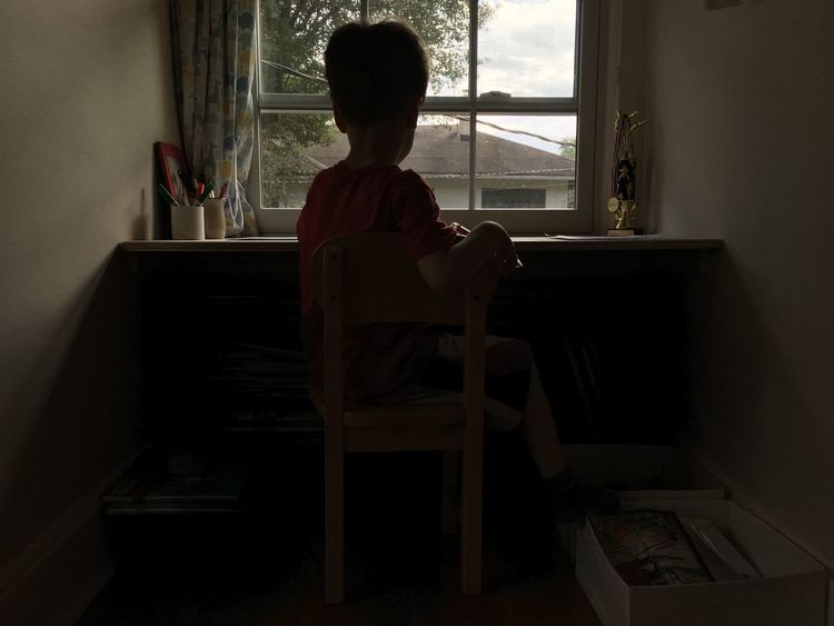 Boy Casual Clothing Contemplation Day Drawing Full Length Homework Kid Leaning Leisure Activity Lifestyles Playing Sitting Sitting On Table Sitting On Window Table Window Writing