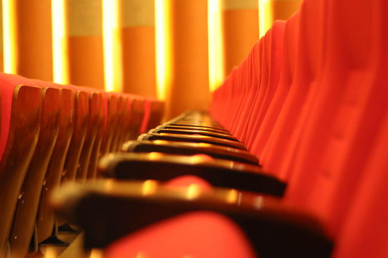 Close-up of empty chairs in movie theater