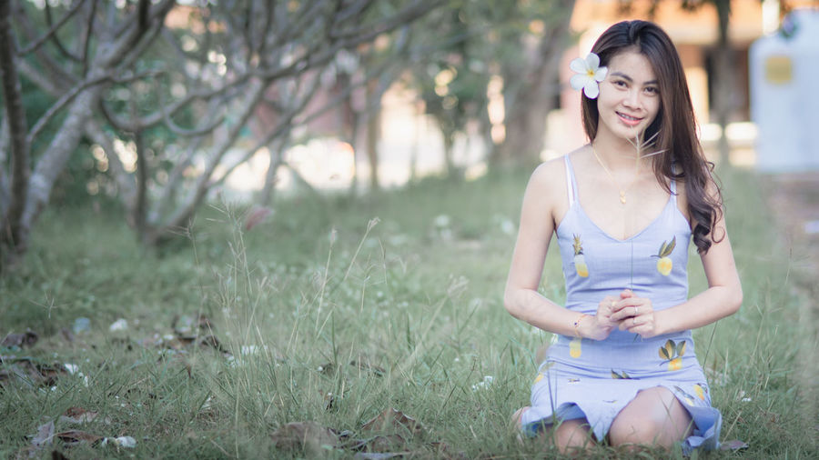 One Person Young Adult Front View Three Quarter Length Casual Clothing Focus On Foreground Plant Beautiful Woman Land Beauty Young Women Women Real People Grass Hairstyle Tree Day Field Long Hair Outdoors