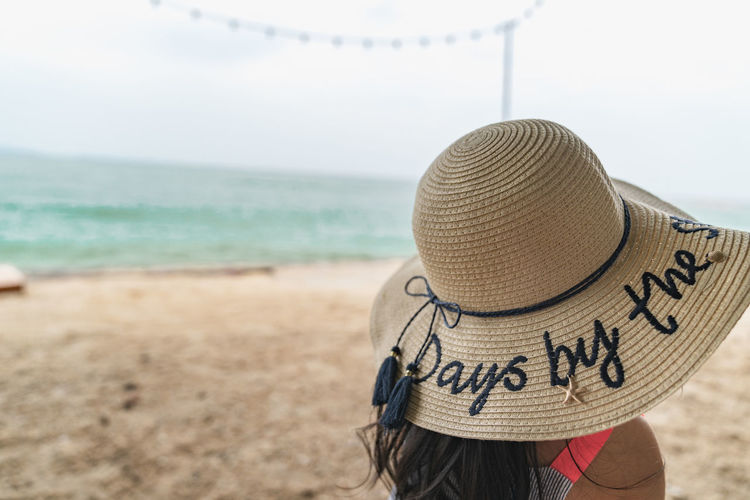 let go to the beach Land Beach Hat Sea Clothing Water Sky One Person Nature Horizon Over Water Day Rear View Focus On Foreground Leisure Activity Sand Casual Clothing Knit Hat Scenics - Nature Real People Outdoors Sun Hat Scarf Holiday
