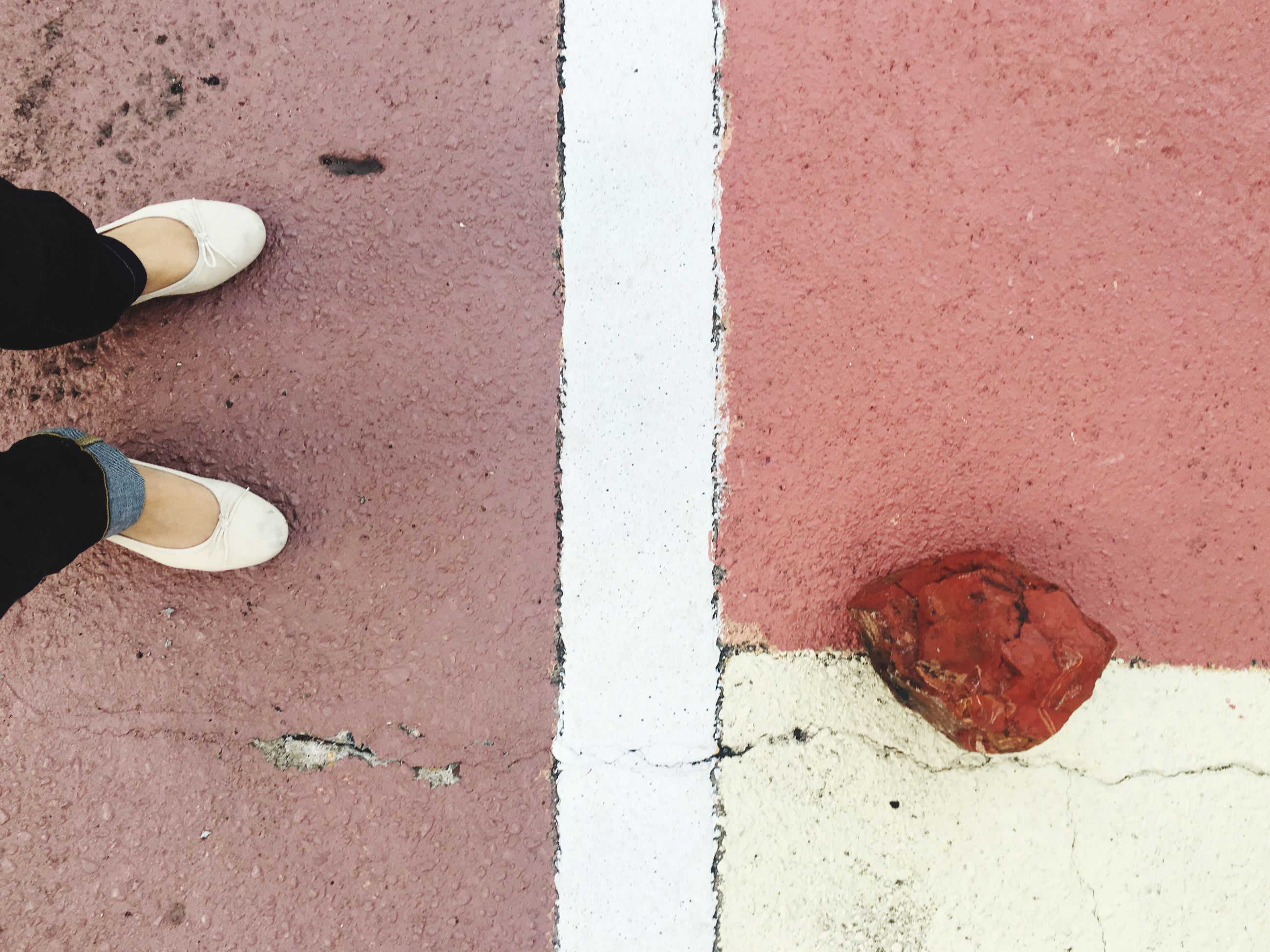 low section, shoe, standing, person, road, transportation, close-up, road marking, part of, red, line, day, outdoors, weathered