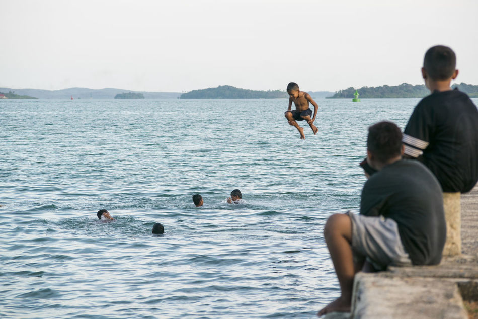 Sea People Young Adult Swim Outdoors Water Small Group Of People Beach Bonding Vacations Day Adults Only Togetherness Men Friendship Swiming Scuba Diving Nature Seascape Check This Out Childhood Streetphotography Swimming Boys Children Carnival Crowds And Details Flying High Art Is Everywhere Live For The Story