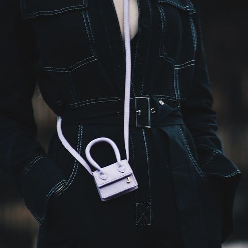 Midsection of woman wearing coat
