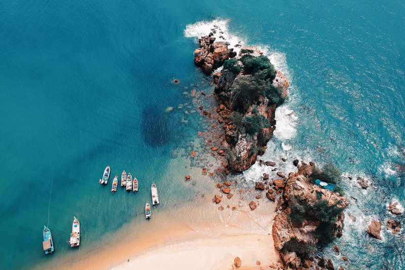 Aerial View Beach Beauty In Nature Day High Angle View Land Mode Of Transportation Nature Nautical Vessel Outdoors Rock - Object Rock Formation Scenics - Nature Sea Ship Solid Tranquil Scene Tranquility Transportation Turquoise Colored Water