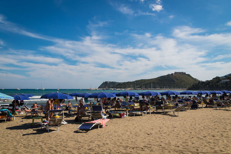 Tuscany Beach Beauty In Nature Chair Cloud - Sky Crowd Day Group Of People Holiday Italy Land Nature Outdoors Sand Sea Sky Summer Sunlight Trip Umbrella Vacations Water